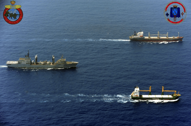 A warship with EU NAVFOR escorts a convoy of ships chartered by the World Food Programme