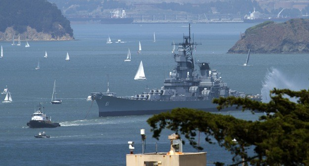 Crowleys tugboat Warrior tows the USS Iowa across San Francisco Bay on May 26 at the start of a four-day tow that ended today, May 30, at a Los Angeles offshore anchorage. Photo: Pacific Battleship Center Photo/Jeremy Bonelle via Crowley