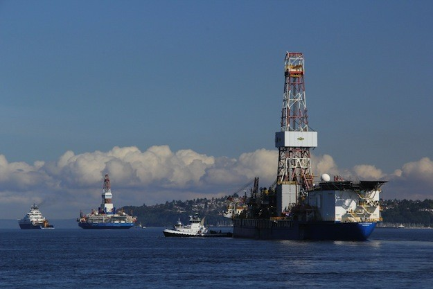 Shell's Kulluk semi-subermisble, Noble Discoverer drillship, and a flotilla of support vessels departed a Seattle shipyard in June expecting to begin drilling within a month. Photo: Vigor