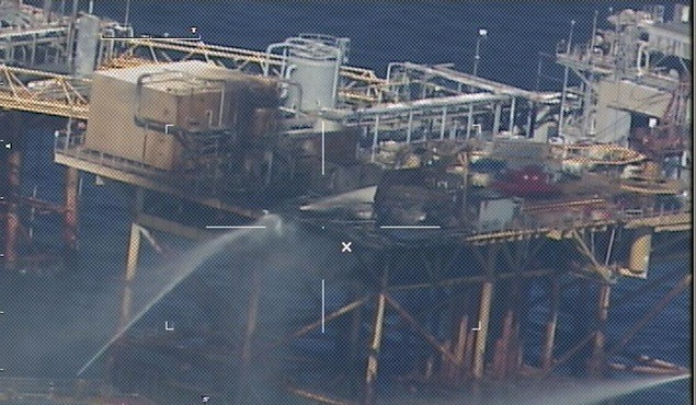 Commercial vessels extinguish a platform fire on board West Delta 32 approximately 20 miles offshore Grand Isle, La., in the Gulf of Mexico, Nov. 16, 2012. Photo: USCG