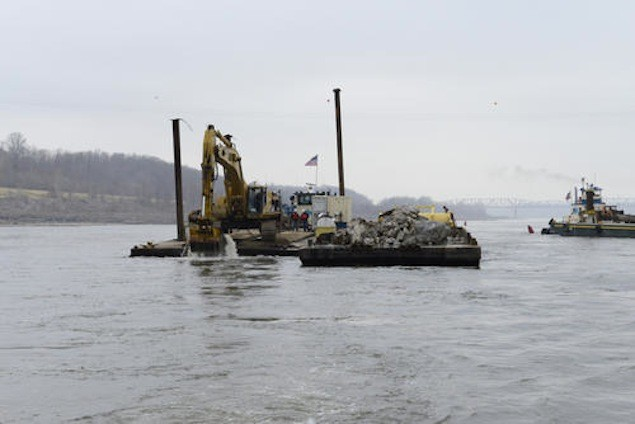 THEBES, Il. - Workers contracted by the Army Corps of Engineers clear rocks from the river floor near Thebes, Il., Dec. 17, 2012. The Coast Guard and USACE are overseeing rock blasting operations due to the low water situation on the Mississippi River. U.S. Coast Guard photo by Petty Officer 3rd Class Ryan Tippets.