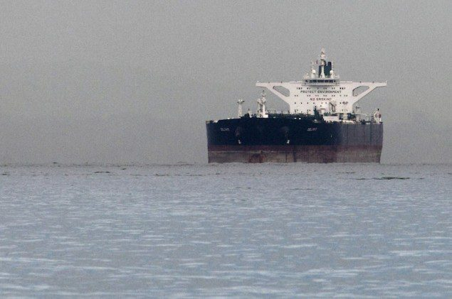 The Malta-flagged Iranian supertanker &quot;Delvar&quot;  is seen anchored off Singapore in this March 1, 2012 file photo. (c) REUTERS/Tim Chong