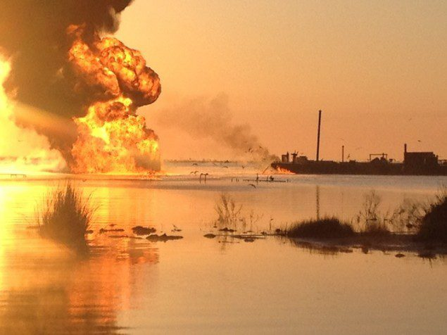 A pipeline burns after an collision with tug boat Shanon E. Setton, near Bayou Perot 30 miles south of New Orleans, March 15, 2013. The Coast Guard is working with federal, state and local agencies in response to this incident to ensure the safety of responders and in insuring the mitigation of any harmful effects to the environment. (Photo courtesy of Terry New)