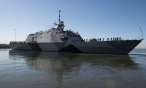 30301-N-BC134-279 SAN DIEGO (March 1, 2013) The littoral combat ship USS Freedom (LCS 1) departs San Diego Bay for a deployment to the Asia-Pacific region. Freedom will demonstrate her operational capabilities and allow the Navy to evaluate crew rotation and maintenance plans. LCS platforms are designed to employ modular mission packages that can be configured for three separate purposes: surface warfare, anti-submarine warfare or mine countermeasures. (U.S. Navy photo by Mass Communication Specialist 3rd Class John Grandin/Released)