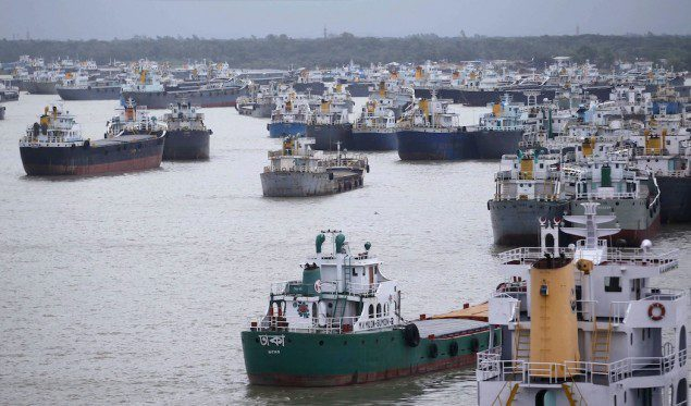 Ships are seen anchored in Karnafuli river before cyclone Mahasen approaches in Chittagong May 16, 2013. Mahasen started crossing Bangladesh's low-lying coast on Thursday, bearing down on the ports of Chittagong and Cox's Bazar, as tens of thousands of people huddled in shelters from a storm which the United Nations says threatens 4.1 million people. REUTERS/Andrew Biraj