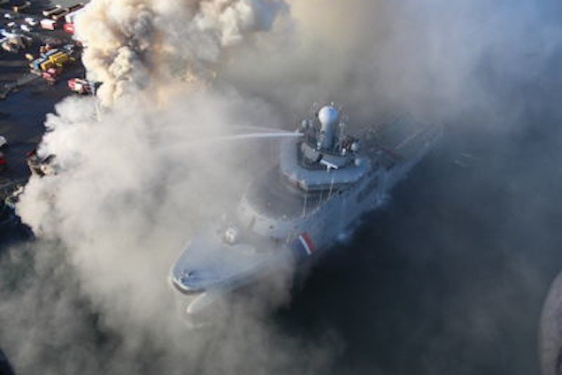 The Icelandic Coast Guard patrol vessel fights a fire onboard the MV Fernanda shortly after the smoldering vessel was towed to port. Image courtesy Icelandic Coast Guard
